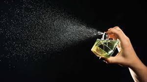 spraying perfume women